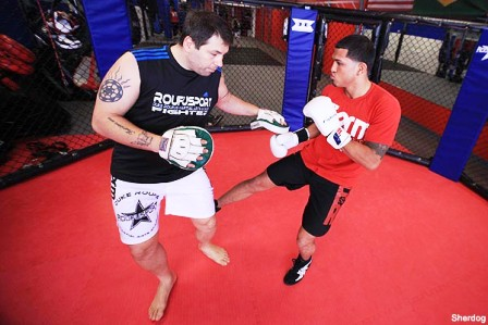Duke Roufus working pads with Anthony Pettis