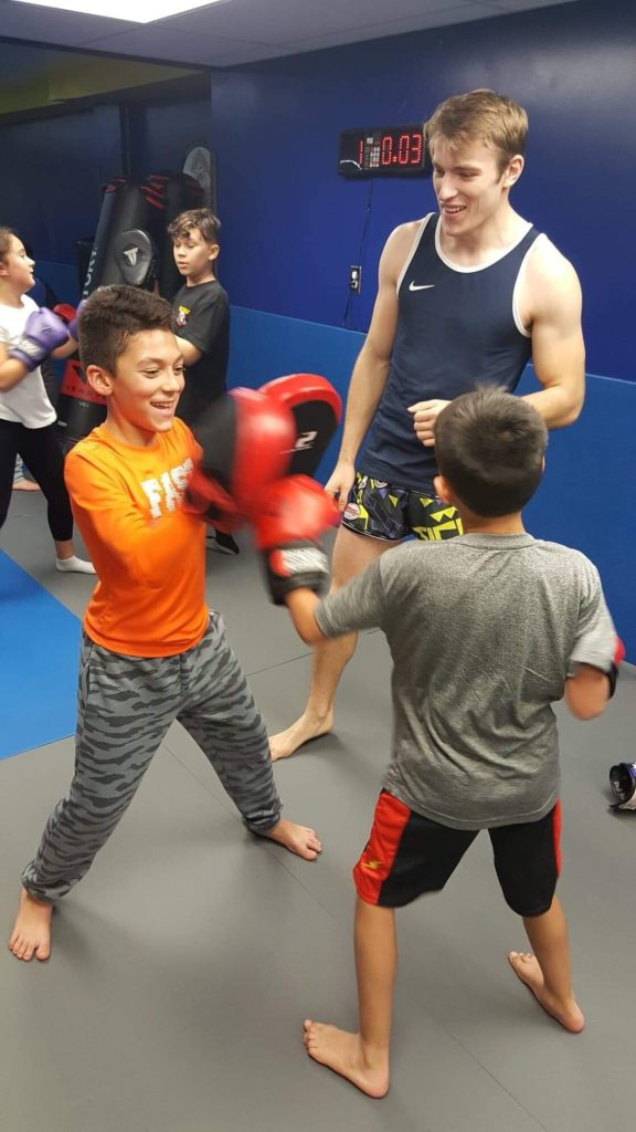 Dmitri Ortin teaching kids Muay Thai